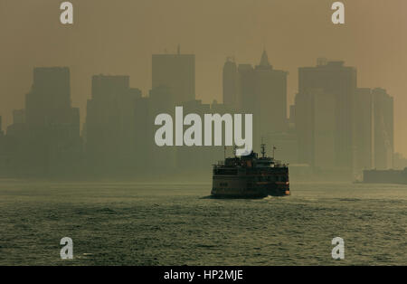 Financial District and Staten Island ferry, New York City, USA - Stock Photo