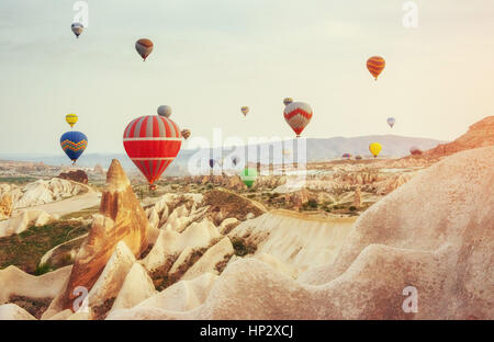 Colorful hot air balloons flying over Red valley at Cappadocia,  - Stock Photo