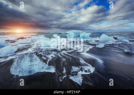 Jokulsarlon glacier lagoon fantastic sunset on the black beach,  - Stock Photo