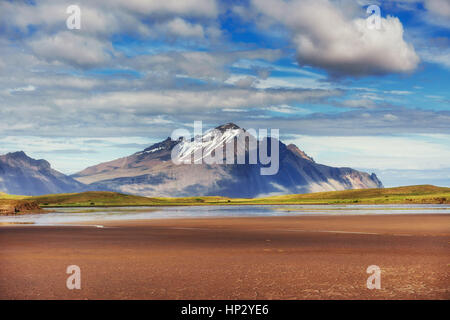 Gentle slopes of snow-capped mountains and glaciers. Wonderful I - Stock Photo