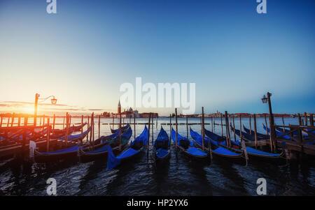 City landscape. Fantastic views of the gondola at sunset, moored - Stock Photo