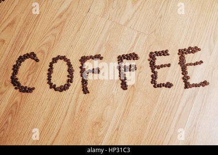Coffee phrase spelled out of roasted beans - Stock Photo