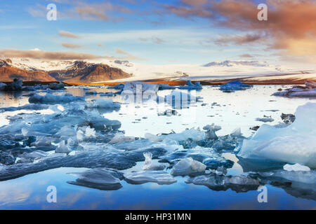 Icebergs floating in Jokulsarlon glacial lake in the west. South - Stock Photo