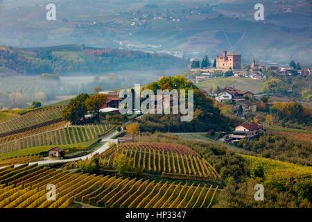 View over vineyards toward Castello di Grinzane Cavour, Langhe Region, Piemonte, Italy - Stock Photo