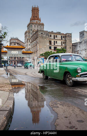Vintage, car, old, taxi,Dragones street, in background Cuban Telephone Company building and main gate of china town, - Stock Photo