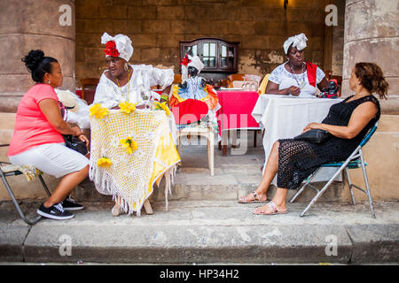 Cuban priestesses, Shaman, Afro-Cuban Santeria religion telling the future and fortune to their clients, cathedral - Stock Photo