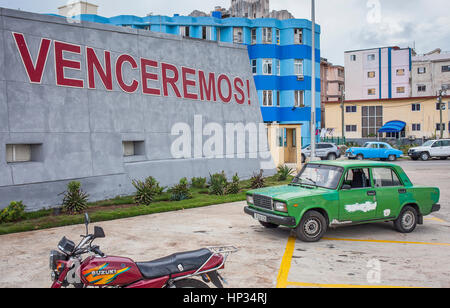 Political message, Catchword in Anti-imperialist Tribune Jose Marti and vintage car, Vedado district, La Habana, - Stock Photo