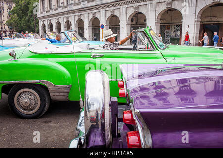 Taxis, taxicab, Street scene in Parque Central, Centro Habana District, La Habana, Cuba - Stock Photo