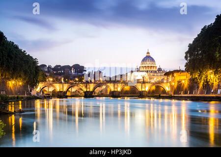 Saint Peter's Basilica with bridge over Tiber, dusk, Rome, Italy - Stock Photo