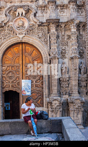 Woman in front of Santisima Trinidad church, Emiliano Zapata street, Mexico City, Mexico - Stock Photo