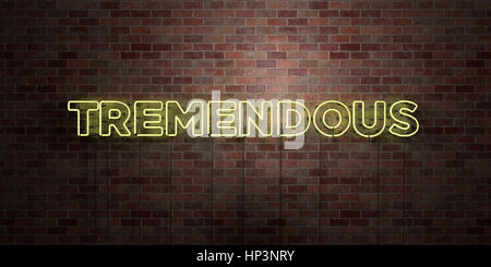TREMENDOUS - fluorescent Neon tube Sign on brickwork - Front view - 3D rendered royalty free stock picture. Can - Stock Photo