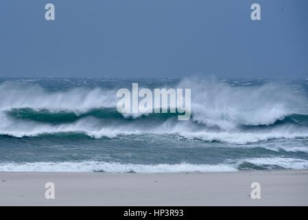 Severe weather, high surf and waves crash upon shore of Mission Beach, San Diego,  California. - Stock Photo