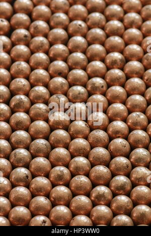 Close up of copper ball bearings - Stock Photo