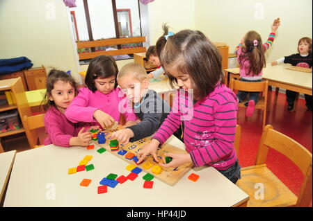 Frankfurt, Germany - November 25, 2011- Refugee children with migration background playing in school. Germany is - Stock Photo