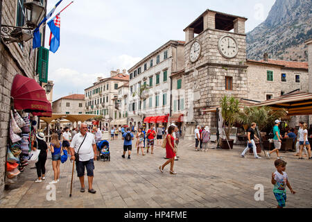 Kotor, Montenegro - August, 2016: St. Luke's Church on St. Luke's square with tourists walkingin Kotor old town. - Stock Photo