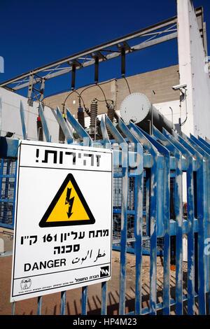 transformer station with warning sign, tel aviv, israel - Stock Photo