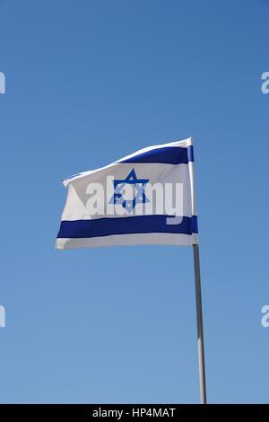 flag of israel blowing in the wind, tel aviv, israel - Stock Photo