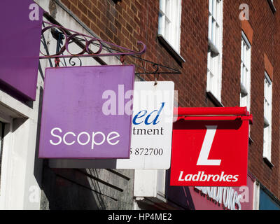 Scope sign above charity shop, UK based disability charity working with disabled people and their families - Stock Photo