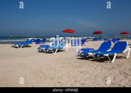 sun lounger at beach, tel aviv, israel - Stock Photo