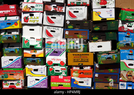close up pile empty cardboard boxes at shop at carmel market, tel aviv, israel - Stock Photo