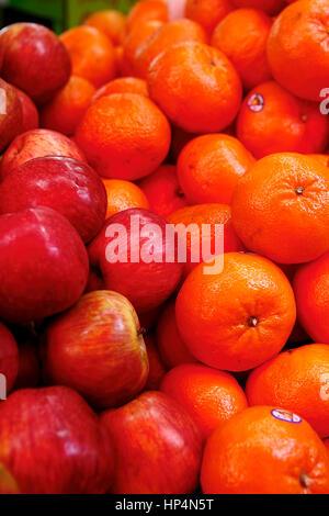 close up apples and oranges at shop in carmel market, tel aviv, israel - Stock Photo
