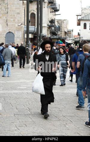 ultra-orthodox jew walking at jaffa street in western part of jerusalem, israel - Stock Photo