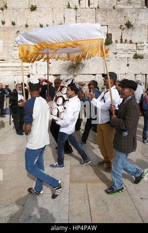young boy celebrating his bar mizwa at western wall, old city, jerusalem, israel - Stock Photo