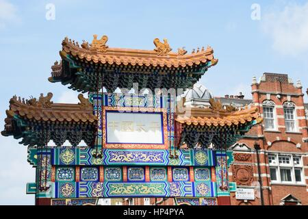 China Town London England, United Kingdom - August 16, 2016: Large Ornate Arch marking Entrance to London's Chinatown - Stock Photo