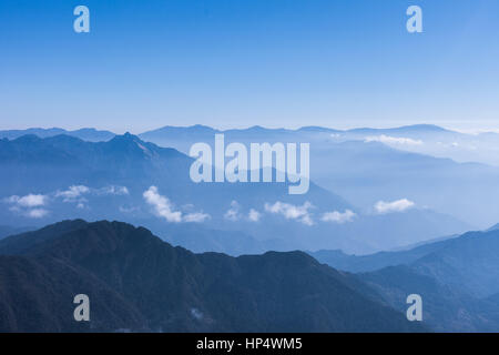 Sun and clouds over Himalayan foothills (Kangchenjunga Himal), eastern Nepal - Stock Photo