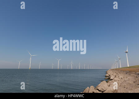 Windturbines  in the water producing alternative energy - Stock Photo