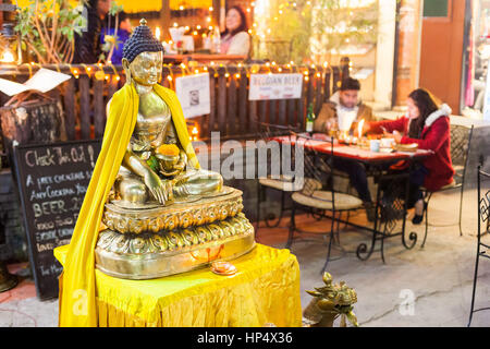 Streetside Buddha statue at a cafe during the 2016 Pokhara Street Festival in Pokhara, Nepal - Stock Photo