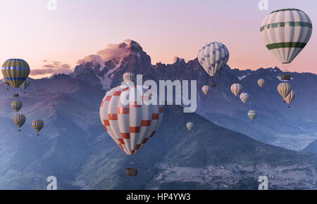 Colorful hot-air balloons flying over the mountain. - Stock Photo