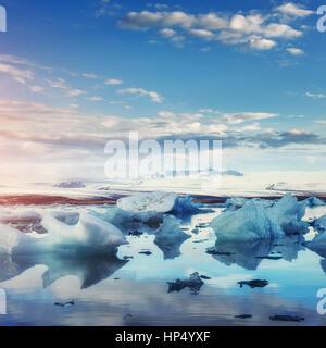 Jokulsarlon glacier lagoon, fantastic sunset on the black beach, - Stock Photo
