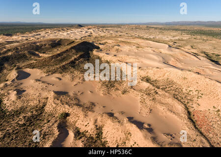 Aerial view of massive sand dunes in the arid region of the Northern Cape, South Africa - Stock Photo