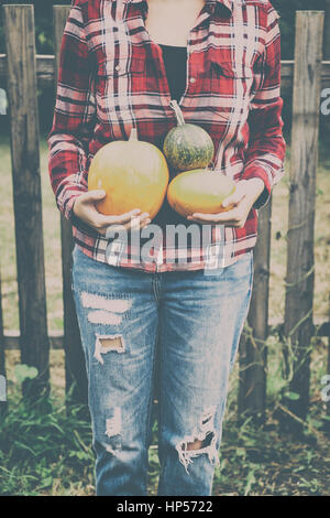 Woman with pumpkins at autumn - Stock Photo