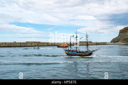 A pirate ship ferry trip around the port of Whitby, Yorkshire, UK - Stock Photo