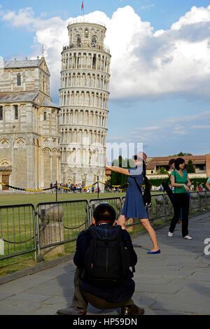 Asian tourist pretend pretending staight straighten Leaning Tower Piazza dei Miracoli Pisa Italy RM World - Stock Photo