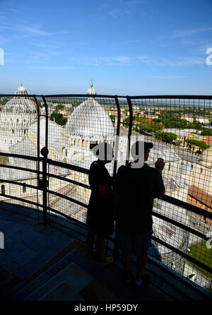 leaning Tower of Pisa, tourists, silhouette, silhouetted, couple, tourism, view, viewing, viewpoint, from, The Baptistery, - Stock Photo