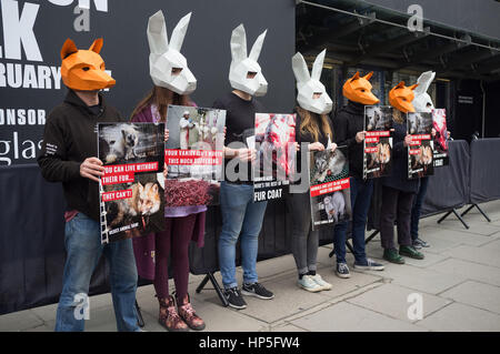 London UK. 18th February 2017. A group of  animal rights protesters stage a protest  against skin trade  outside - Stock Photo