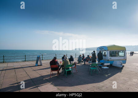Penzance, Cornwall, UK. 18th Feb 2017. UK Weather. People enjoying a sunny half term afternoon on the promenade at Penzance this afternoon. Credit: Simon Maycock/Alamy Live News Stock Photo