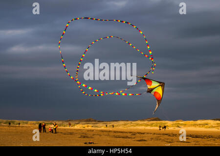 Southport, Merseyside, UK.  Weather. 18th February, 2017. 12C. as Precision Stunt Kites fly on Ainsdale Beach. Barmy - Stock Photo