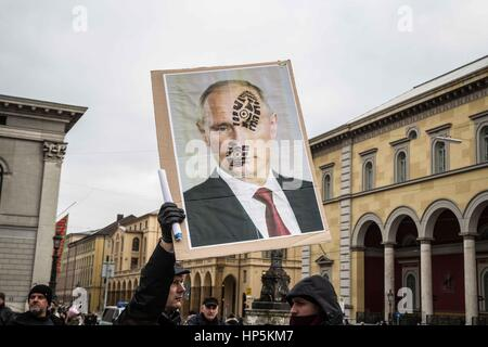 Munich, Germany. 18th Feb, 2017. Putin face with boot print. Anti-MSC protests organized by far- and radical-rightists - Stock Photo