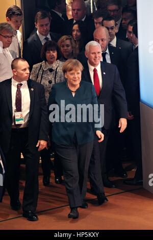 Munich, Germany. 18th Feb, 2017. German Chancellor Angela Merkel escorts U.S. Vice President Mike Pence to the Munich - Stock Photo