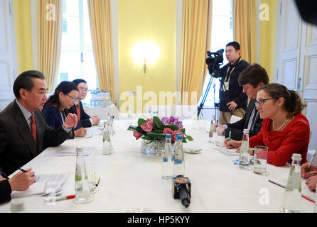 Munich, Germany. 18th Feb, 2017. Chinese Foreign Minister Wang Yi (1st L) meets with his Canadian counterpart Chrystia - Stock Photo