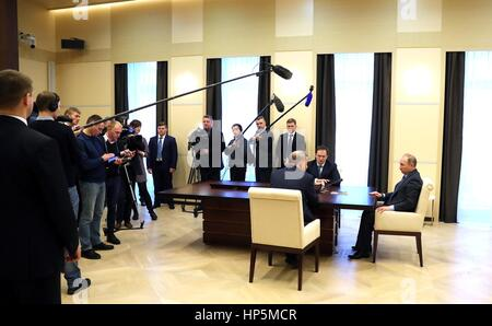 Russian President Vladimir Putin holds a meeting with Russian Culture Minister Vladimir Medinsky, left, and general - Stock Photo