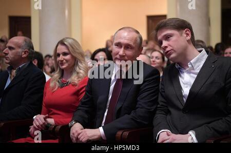 Russian President Vladimir Putin sits with Yevgeny Chernyadyev, principal singer of the Mariinsky Theater, right, - Stock Photo