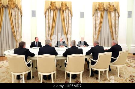 Russian President Vladimir Putin meets with the retired governors of Buryatia, Karelia, Perm Territory, Novgorod - Stock Photo