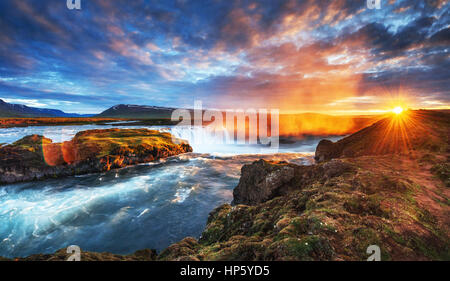 The picturesque sunset over landscapes and waterfalls. Kirkjufel - Stock Photo