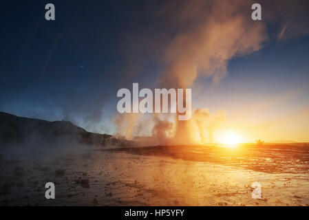 Fantastic sunset Strokkur geyser eruption in Iceland - Stock Photo