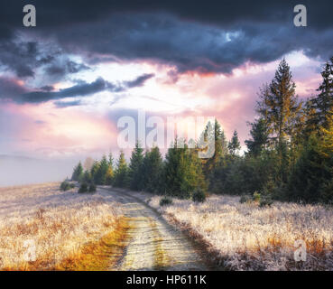 October mountain range in the first winter days. Road to hoarfro - Stock Photo